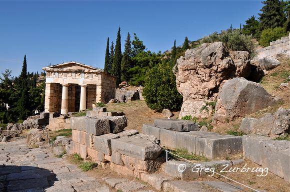 The Treasury of the Athenians on the left and the Sibyl Rock on the right. The woman who was the first oracle sat on top of this rock giving her prophecies.